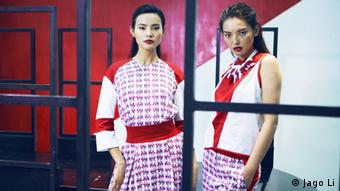 Two models wear Ralf Schuchmann's China Surrealism line of clothing Photo: Jago Li