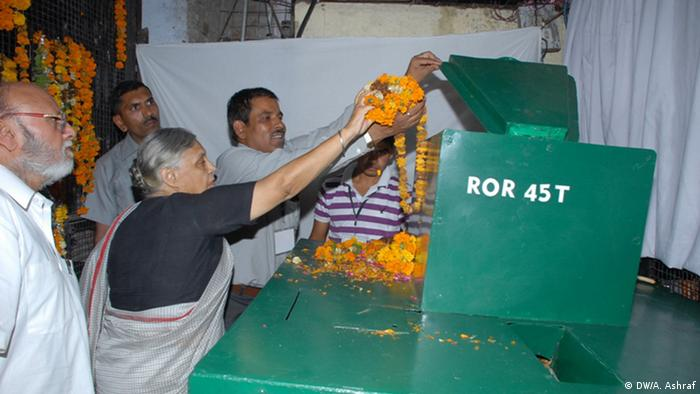 People load temple flowers into a large green processing machine in New Delhi (Photo: ORM Green)