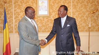 CAR president Djotodia shakes hands with President Deby of Chad
