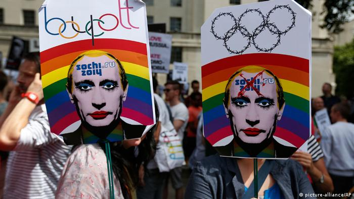 Activists holding placards depicting Russian President Vladimir Putin, participate at a protest against Russia's new law on gays (photo: AP Photo/Lefteris Pitarakis)