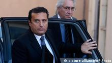 Costa Concordia Captain Francesco Schettino arrives at the Grosseto court, Italy, where the trial for the crash of the Concordia liner, which struck a reef as it sailed close to the Giglio island, causing the death of thirty people, is under way Tuesday, Dec. 17, 2013. Ciro Ambrosio, who was serving as First Officer on Jan. 13, 2012 during the crash, told a court in Tuscany Tuesday he had to communicate with hand gestures with Captain Francesco Schettino because the commander was chatting on the phone. Ambrosio said he was off-duty but took the helm and gave orders to the helmsman because Schettino was distracted by the phone conversation. (AP Photo/Alessandro La Rocca, Lapresse) ITALY OUT pixel