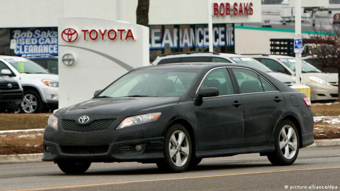 A Toyota Camry leaves ashowroom in the US