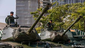 Thai soldiers sit on top of tanks at the Army base in central Bangkok January 10, 2014. (Photo: Reuters)