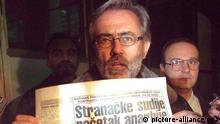 Slavko Curuvija, the owner and chief editor of independent news Dnevni Telegraf (Daily Telegraph), holds the remaining copy of his paper after Belgrade police confiscated about 100,000 copies late Monday 9th November 1998.. A court fined the chiefs of an independent daily 1,200 000 thousand Dinars for breaching Serbia's restrictive new information law, media reported Monday.The verdict and the trial against the newspaper, known for its criticism of President Slobodan Milosevic's autocratic regime, came only a day after it resumed publishing following weeks of government bans, court trials and police raids. dpa