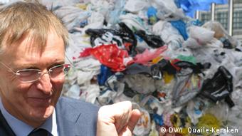 Commissioner Potocnik in front of plastic waste