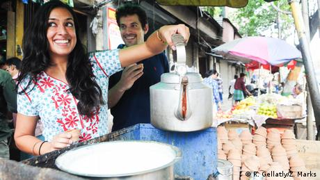 Resham Gellatly and Zach Marks at a tea stall in India