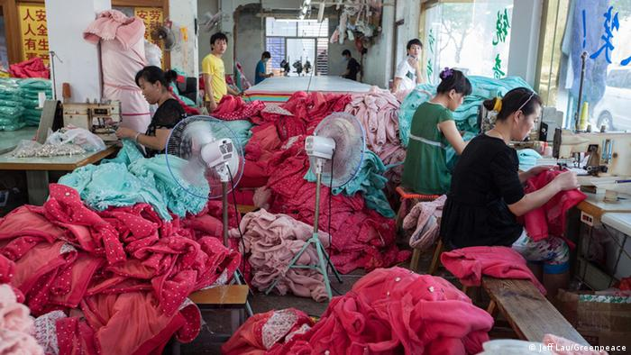 Workers spend their day assembling children's wear in a textile factory in Huzhou, China.
