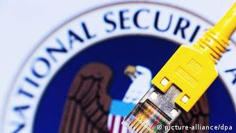 NSA logo and cable (photo: Jens Büttner/dpa)