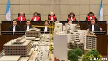 Judges (top row, L-R) Walid Akoum, Janet Nosworthy, David Re, Micheline Braidi and Nicola Lettier preside over the courtroom of the Special Tribunal for Lebanon in The Hague, The Netherlands, January 16, 2014. The trial in absentia of the four suspects accused of killing Lebanese statesman Rafiq al-Hariri opened in The Hague on Thursday, nine years after the bomb attack in which the former prime minister and 21 others died. REUTERS/Toussaint Kluiters/United Photos (NETHERLANDS - Tags: POLITICS CIVIL UNREST CRIME LAW)