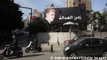 A billboard bearing a portrait of late Lebanese premier Rafiq Hariri is displayed with the Arabic slogan 'The Era of Justice' on a main road in the Lebanese capital Beirut on January 16, 2014, as four Hezbollah members went on trial in absentia at a UN-backed tribunal in the Netherlands, accused of murdering the former prime minister in a 2005 car bombing. The trial opened in a suburb of The Hague nine years after the huge Beirut blast that killed the billionaire Hariri and just hours after another car bombing killed at least three in a Hezbollah stronghold near the border with war-ravaged Syria. AFP PHOTO/ANWAR AMRO (Photo credit should read ANWAR AMRO/AFP/Getty Images)