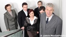 Business people ascending office stairs towards camera Jasmin Merdan - Fotolia #42066570
