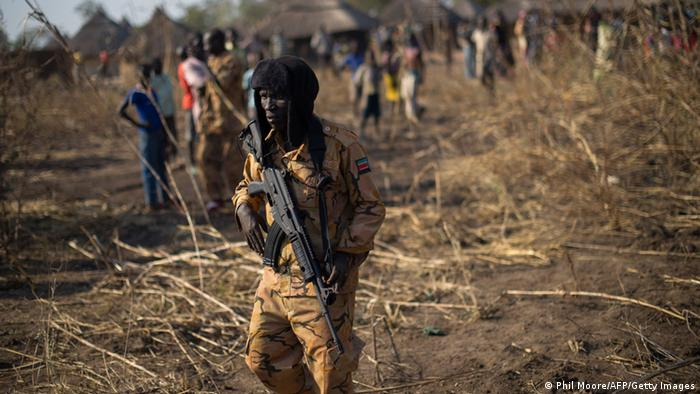 A South Sudanese policeman walks in the outskirts of Mvolo, 75 miles from Rumbek in the Western Equatoria State, on January 14, 2014. Photo: PHIL MOORE/AFP/Getty Images