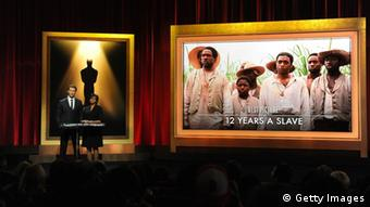 An image from the film is projected on a stage where the Oscar nominees are announced