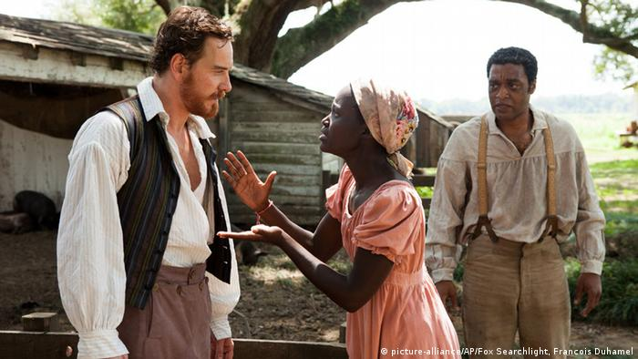 Two actors and an actress in one of the scenes of 12 Years a Slave movie