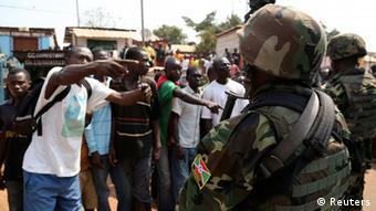 Angry men point at AU soldiers. (Photo: REUTERS/Emmanuel Braun)
