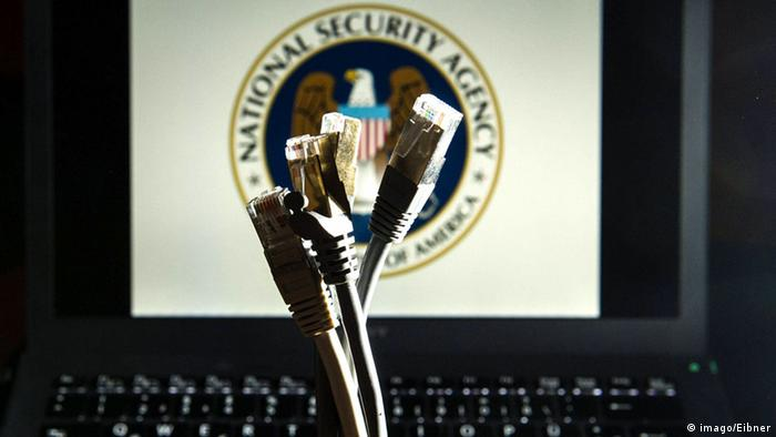 Network cables in front of a monitor showing the NSA's emblem Photo: imago/Eibner