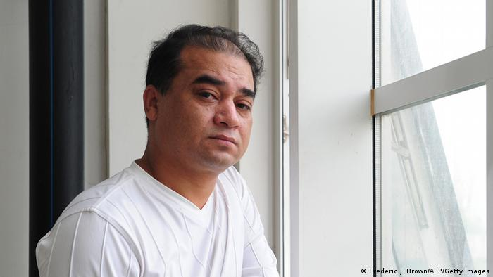 University professor, blogger, and member of the Muslim Uighur minority, Ilham Tohti pauses before a classroom lecture in Beijing on June 12, 2010.