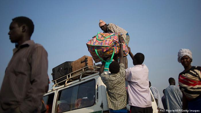 Men load bags onto a minibus in the South Sudanese capital of Juba as people prepare to leave for the Kenyan refugee camp of Kakuma on January 17, 2014 (Photo: PHIL MOORE/AFP/Getty Images)