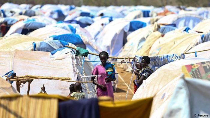 Several South Sudanese refugees are talking to each other in the midst of a sea of tents in the Dzaipi camp in Uganda. (Photo: Reuters)
