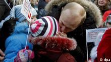 Weihnachtsmesse in Weliki Ustjug - Putin und Kind