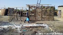 Bildergalerie Südsudan Der jüngste Staat der Welt versinkt im Chaos - Mann mit Plastiktüte (Foto: Jan-Philipp Scholz/Adrian Kriesch)