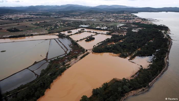 An aerial view shows flooded areas in Hyeres, southeastern France, the day after heavy rains hit the region, January 20, 2014. REUTERS/Anne-Christine Poujoulat/Pool