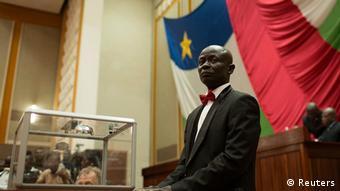 A man stands beside a glass ballot box. ( Photo: REUTERS/Siegfried Modola)