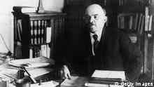 circa 1922: Russian revolutionary, Vladimir Ilyich Lenin (1870 - 1924), in his office. (Photo by Topical Press Agency/Getty Images)