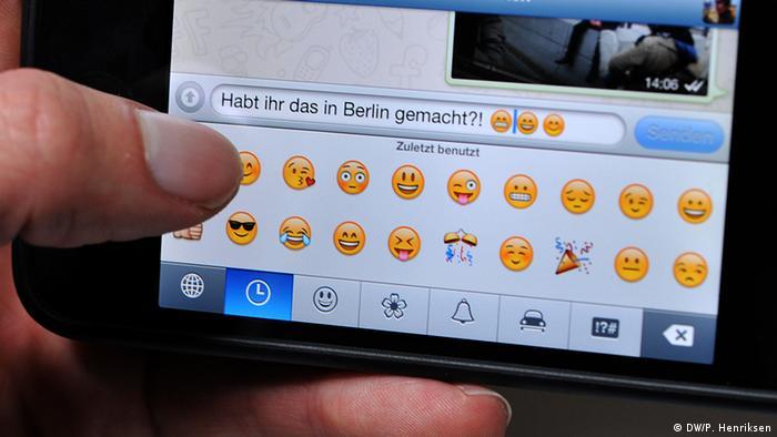 Smart phone with emojis in WhatsApp Photo: DW/Per Henriksen