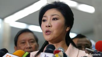 Thai Prime Minister Yingluck Shinawatra speaks to reporters following the declaration of a state of emergency in Bangkok January 21, 2014. The Thai government on Tuesday declared a 60-day state of emergency to start on Wednesday, saying it wanted to prevent any escalation in more than two months of protests aimed at forcing Yingluck from power.