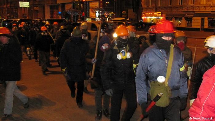 Activists wearing balaclavas