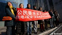 Supporters of Xu Zhiyong, one of China's most prominent rights advocates, shout slogans near a court where Xu's trial is being held, in Beijing January 22, 2014. Xu, 40, stands trial on Wednesday on a charge of gathering a crowd to disturb public order punishable by up to five years in prison. His case will almost certainly spark fresh criticism from Western governments over Beijing's crackdown on dissent. The slogan on the placard reads: Citizens request officials to publicly disclose assets. )