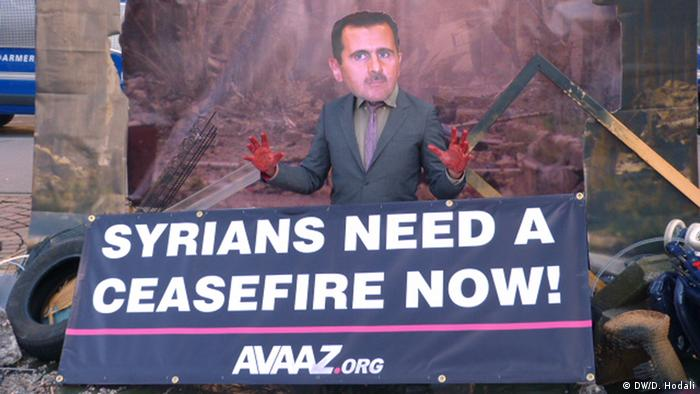 Avaaz.org protester dressed as Assad with fake blood on his hands Photo: DW, Diana Hodali