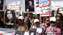 TO GO WITH AFP STORY BY GUILLAUME KLEIN (FILES) A picture dated on March 17, 2012 shows women holding posters as they protest against the suicide of Amina al-Filali, 16, who was forced to marry the man who raped her outside the parliament in Rabat . Defenders of women's rights in Morocco are inching closer to a long-awaited goal as the kingdom's parliament works to amend a law that allows a rapist to escape prison by marrying his victim. Morocco was shocked in March 2012 by the suicide of Amina Filali, 16, who was forced to marry the man who had raped her. He remained a free man under Article 475 of the kingdom's penal code. AFP PHOTO / STR (Photo credit should read STR/AFP/Getty Images)