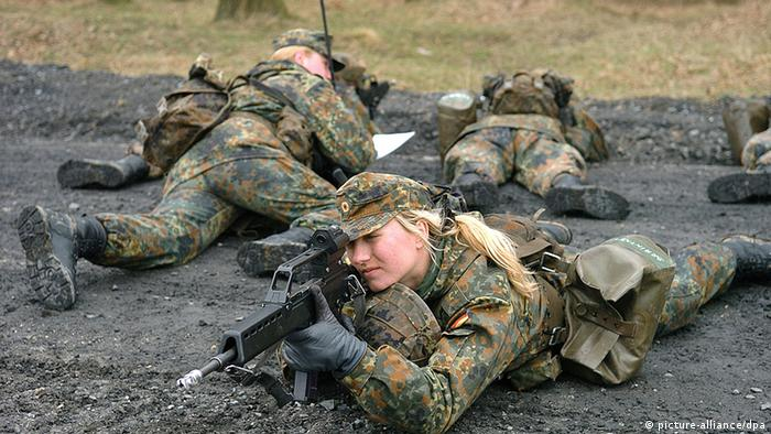 Female German army officers undergoing armed combat training