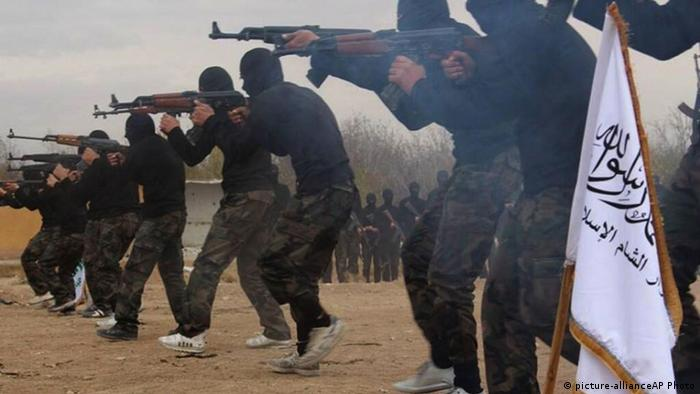 In this undated file picture released on Friday Nov. 29, 2013, and posted on the Facebook page of a militant group, members of Ahrar al-Sham brigade, one of the Syrian rebels groups, exercise in a train camp at unknown place in Syria. (Picture via AP Photo, File)