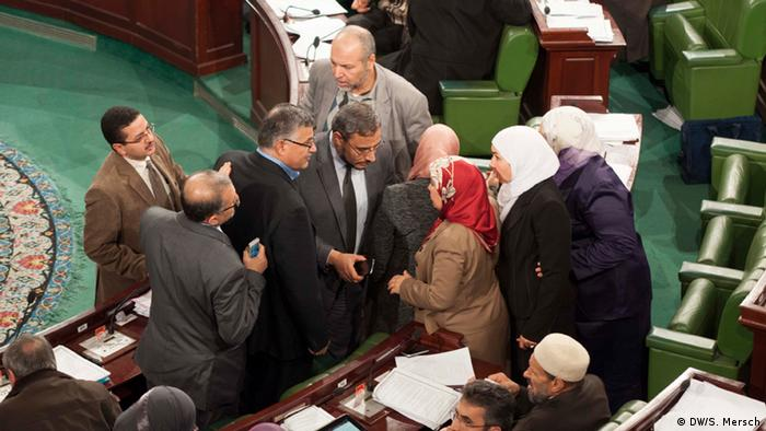 Tunisian politicians engaged in a discussion in parliament