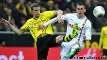 Dortmund's Sven Bender (L) vies for the ball with Augsburg's Arkadiusz Milik during the German Bundesliga soccer match between Borussia Dortmund and FC Augsburg at the SignalIdunaPark in Dortmund, Germany, 25 January 2014. Photo: JAN-PHILIPP STROBEL (ATTENTION: Due to the accreditation guidelines, the DFL only permits the publication and utilisation of up to 15 pictures per match on the internet and in online media during the match.)