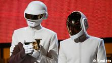 Daft Punk accept the award for record of the year for Get Lucky at the 56th annual Grammy Awards in Los Angeles, California January 26, 2014. REUTERS/Mario Anzuoni (UNITED STATES - Tags: ENTERTAINMENT) (GRAMMYS-SHOW)