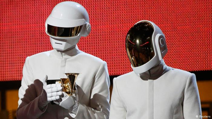 Daft Punk accept the award for record of the year for Get Lucky at the 56th annual Grammy Awards in Los Angeles, California January 26, 2014. REUTERS/Mario Anzuoni