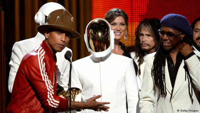 Musicians Pharrell Williams, Thomas Bangalter and Guy-Manuel De Homem-Christo of Daft Punk, and Nile Rodgers accept the Record of the Year award for 'Get Lucky' onstage