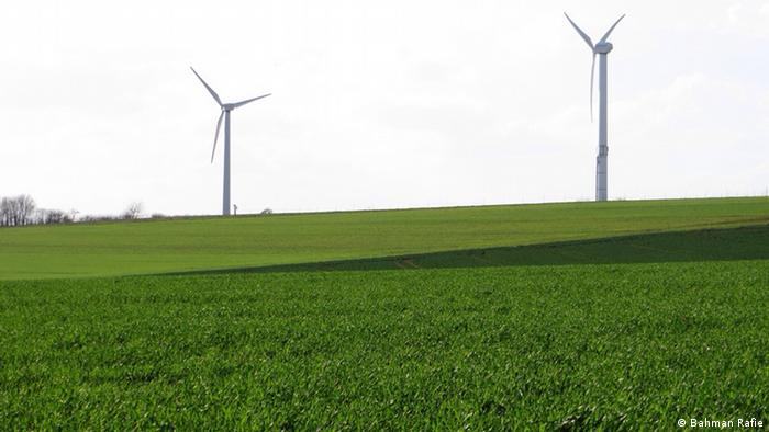 Two wind turbines in a field Photo: Bahman Rafie