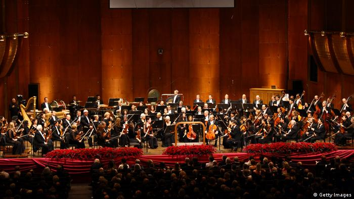 The New York Philharmonic Orchestra on stage (c) Getty