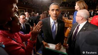Barack Obama walks through a crowd of onlookers at his State of the Nation address in 2014