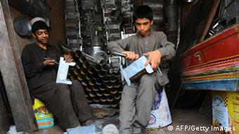 Afghan youths working in a bazaar
