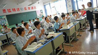 In this photo taken on October 15, 2012 schoolboys listen to their teacher in class at the government-run Shanghai Number Eight High School in Shanghai. Shanghai, whose school system produces the world's top test-scorers, has launched China's first all-boys high school programme with an eye on elite overseas institutions like Eton.
