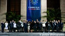 HAVANA, Jan. 29, 2014 (Xinhua) -- Dignitaries pose in front of the Revolutionary Palace for the family photo of the CELAC (Community of Latin American and Caribbean Countries) summit in Havana, Cuba in Havana, capital of Cuba, Jan. 28, 2014.(Xinhua/Liu Bin)(ctt) XINHUA /LANDOV