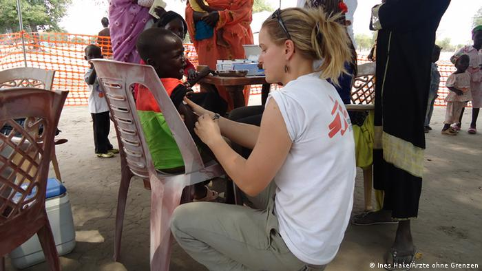 Nurse Ines Hake is treating a young boy in South Sudan