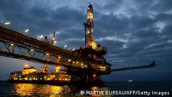 Oil platform lit up against a dark sky