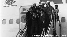Tehran, IRAN: (FILES) Photo taken 01 February 1979 at Tehran airport of revolutionary leader Ayatollah Ruhollah Khomeini (up front R) leaving the Air France Boeing 747 jumbo that flew him back from exile in France to Tehran. Iran is set to buy the plane, a government newspaper said 29 January 2006. Although Iran's US-backed shah had already fled the country when Khomeini returned from exile in the small French town of Neauphle-le-Chateau, the 747's landing is seen as the true start of the Islamic revolution. AFP PHOTO GABRIEL DUVAL (Photo credit should read GABRIEL DUVAL/AFP/Getty Images)